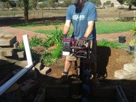 Digging a drainage/soakage pit.