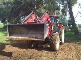 "Farmer John's ""small tractor""."