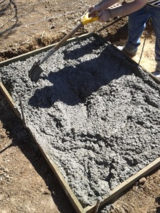Pouring the pad for the boy's house.