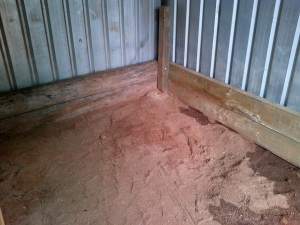 "Reinforcing with uprights and sleepers. In stables these are called ""kick boards"". In a pig shed, they're ""lean boards""."