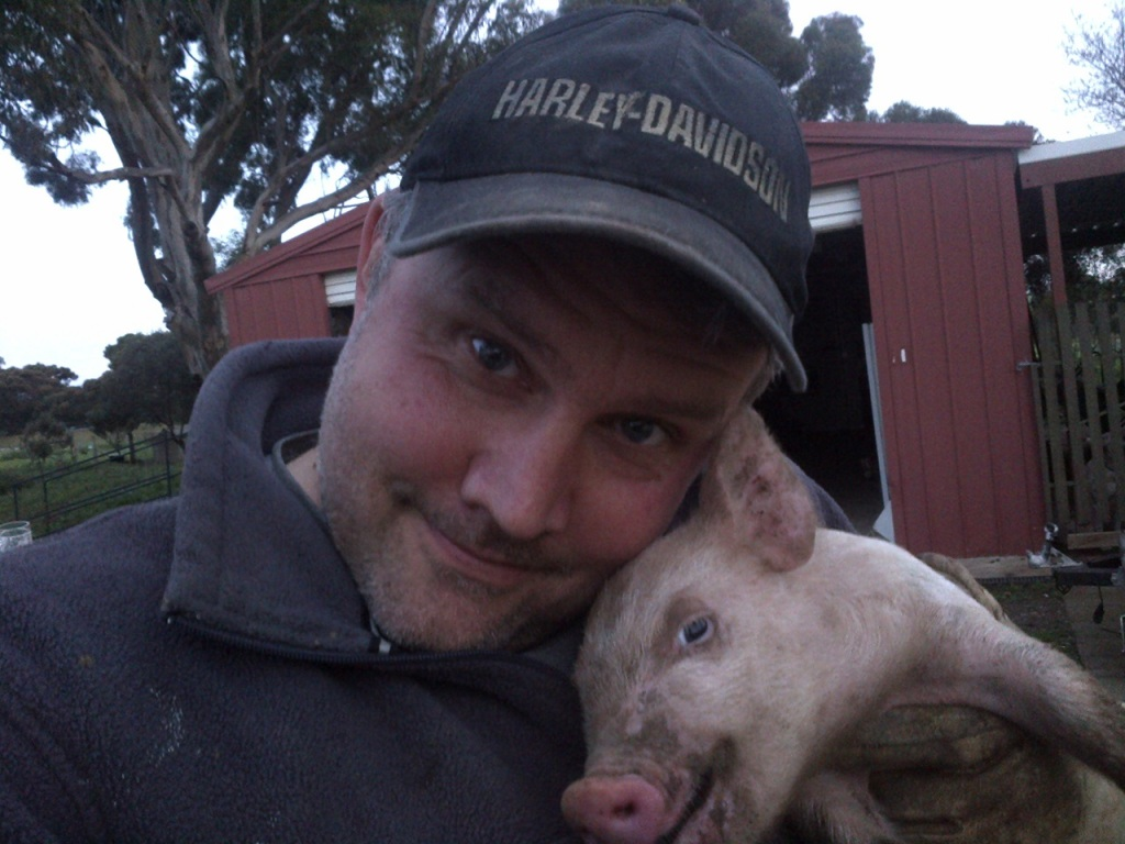 I forget what was wrong with this little guy, but I had to grab him out for some reason. It seemed like a great chance for a piglet selfie.